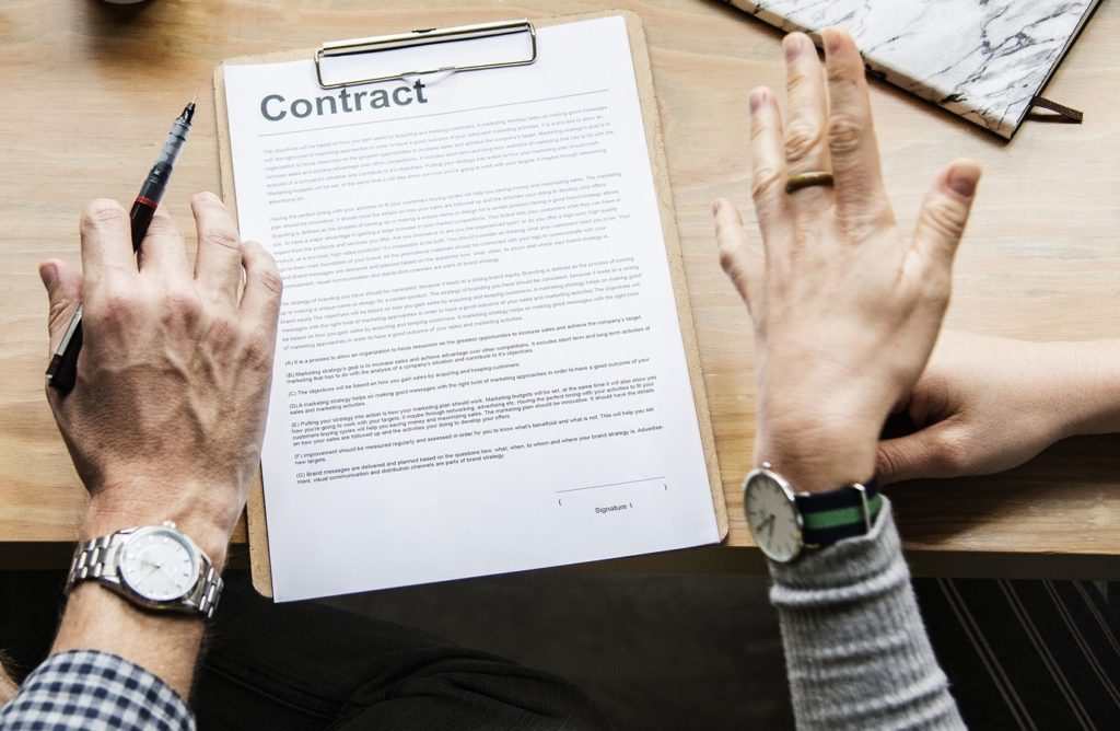 Contractual agreement being reviewed - Painter and Cole HR Consultants can help you with this